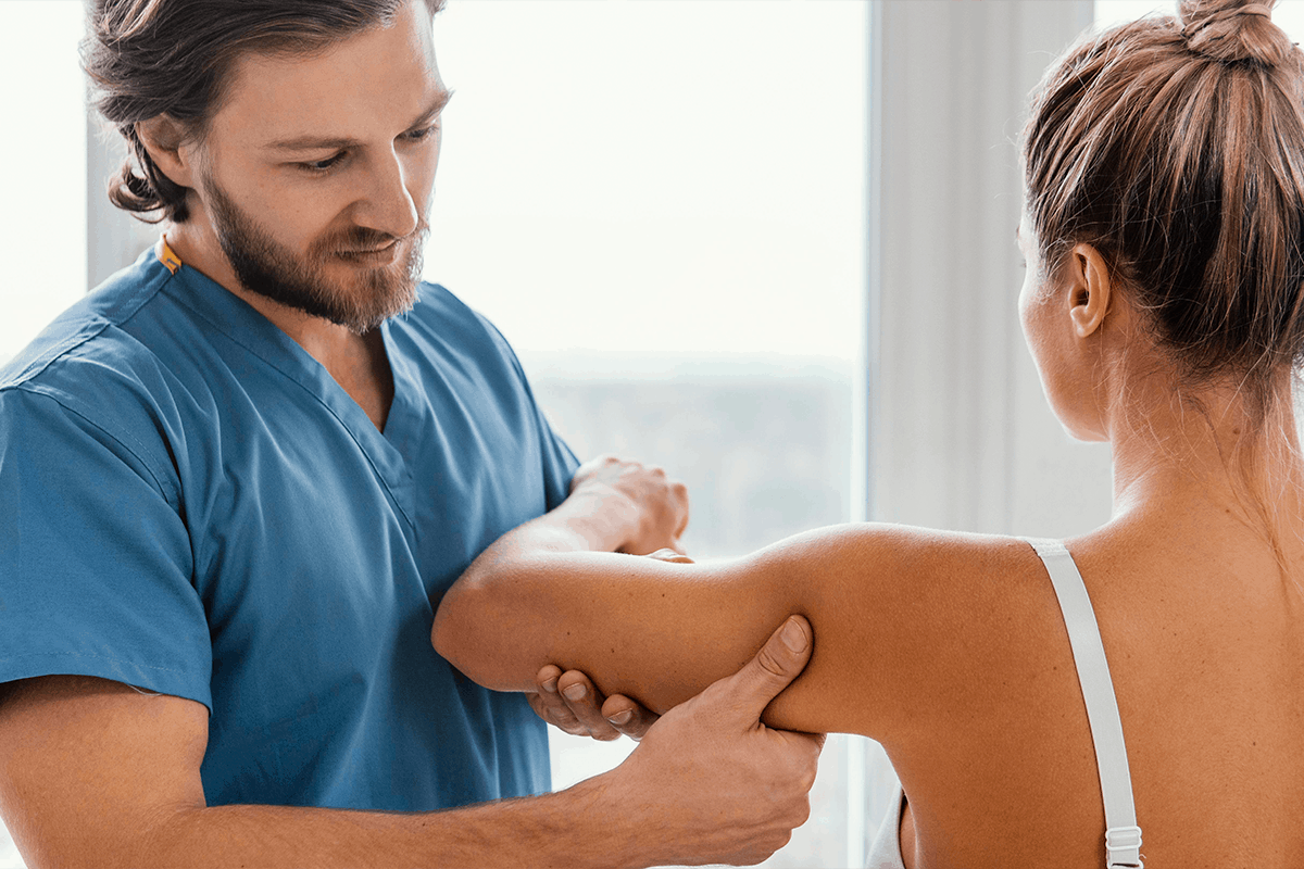 Specialist examines patient for Musculoskeletal disorders